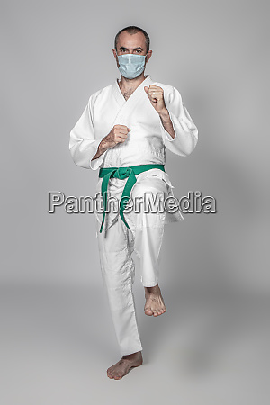 martial arts practitioner wearing a mask
