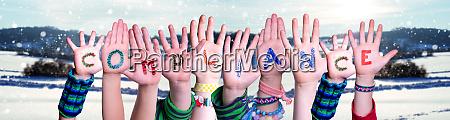 children hands building word compliance snowy