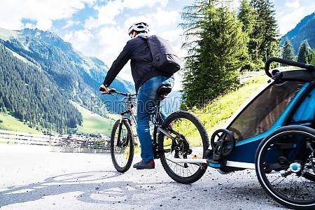 man with e bike mtb and