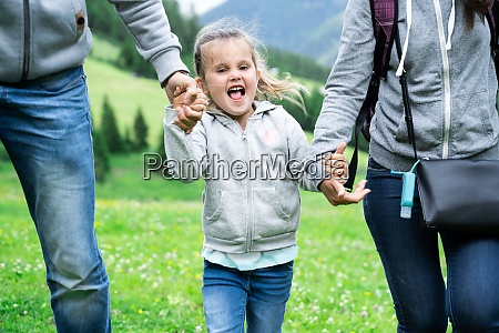 family couple run with young child
