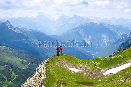 photographer woman taking mountain photo