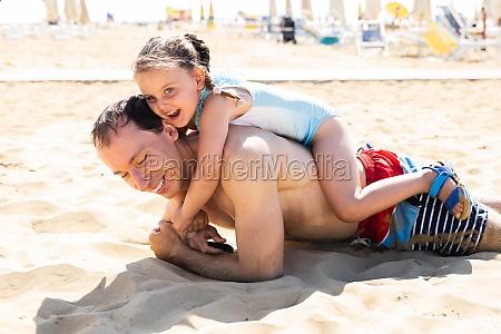 family people having fun at beach