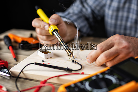 electrician technician at work electronics