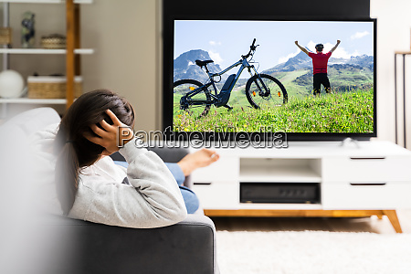 women watching tv at home