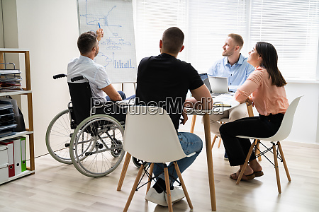 wheelchair and disability at office giving