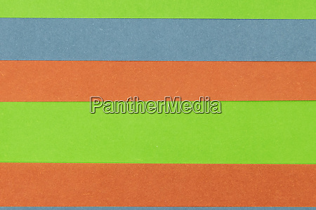 green orange and blue coloured paper