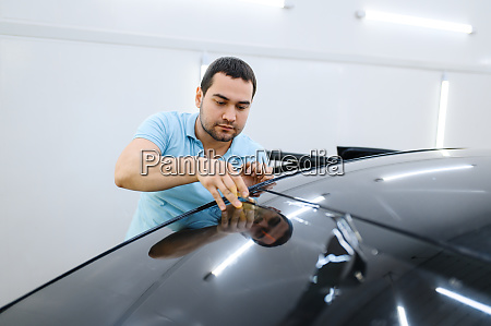 male wrapper cuts car tinting tuning