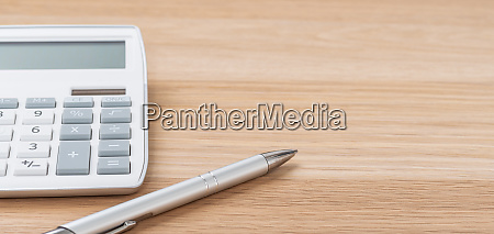 a calculator and a pen with