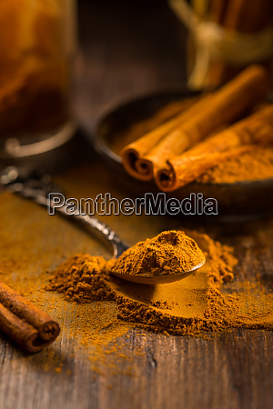cinnamon powder in vintage spoon with