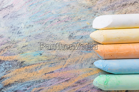 chalks with colorful painted background