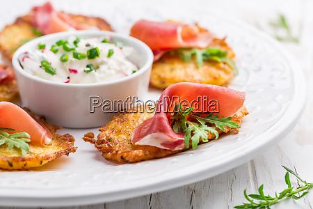 potato pancake with prosciutto and dip