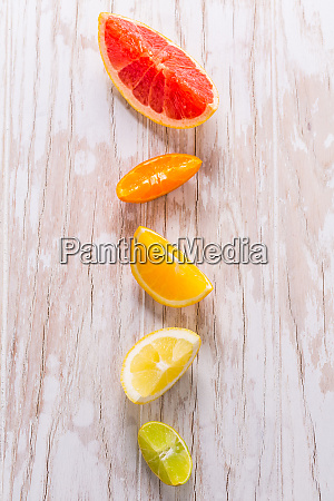 slices of citrus fruits on wooden