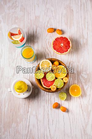 assortment of citrus fruits on wooden