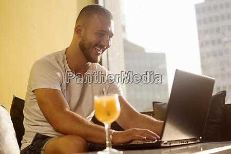 freelancer guy using laptop