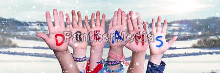 children hands building word dreams snowy