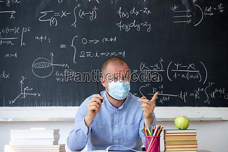 male teacher in the classroom wearing