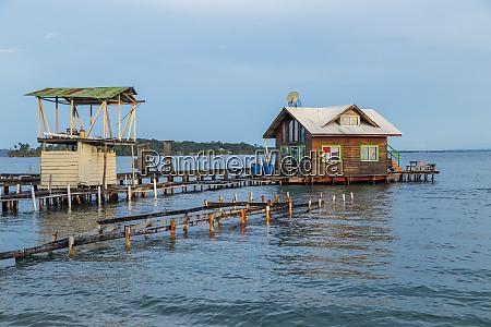caribbean houses over the sea