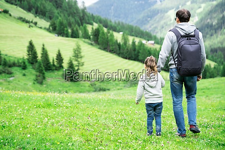 father with child girl in mountains