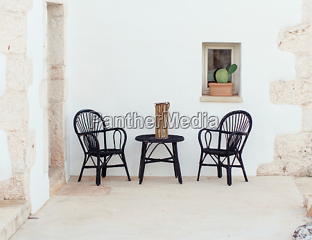 black table and chairs near a