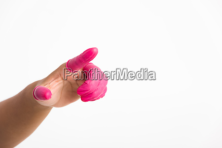 woman hand wearing pink finger cots