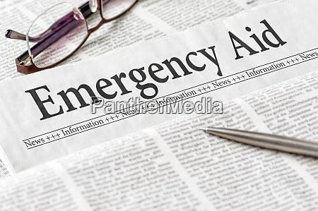 a newspaper with the headline emergency