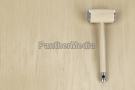meat tenderizer on wooden table