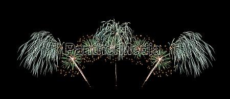 green fireworks exploding on black sky