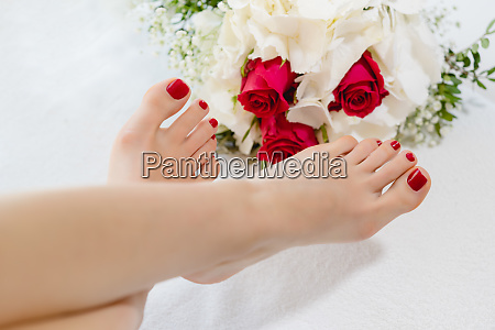 feet of women with red toenails