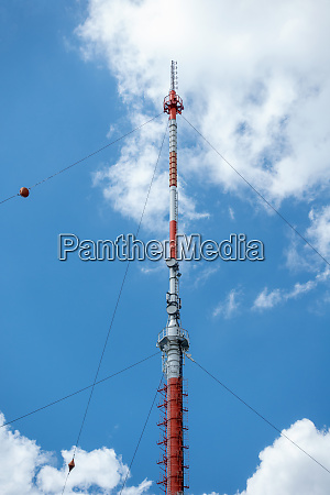 transmission mast against the blue sky