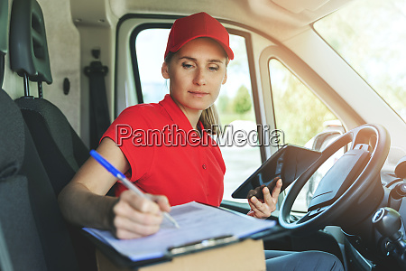 delivery person in red uniform sitting
