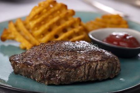 steak with potato lattices