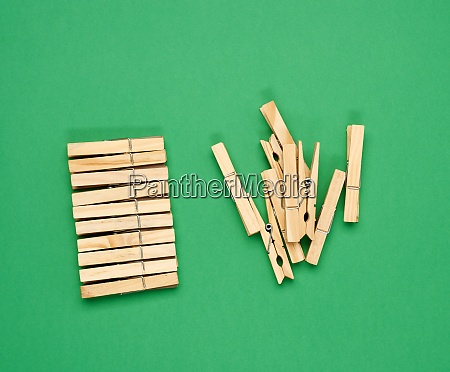 stack of wooden clothespins on green