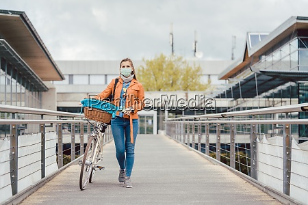 woman with face mask pushing her