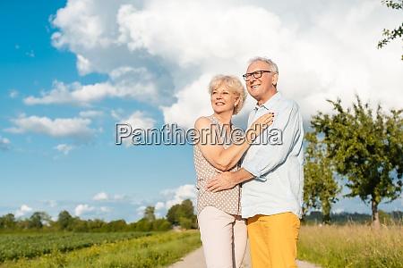 senior couple in summer landscape looking