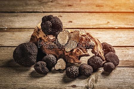 whole and slices black truffle mushrooms