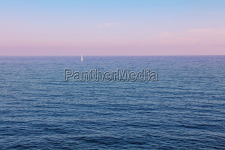 tranquil sunset seascape with pink sky