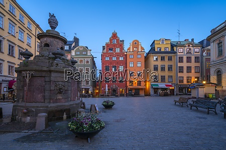 dusk over the colorful facades of