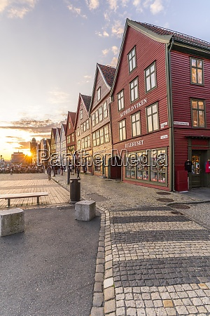 sunset over cobblestone street and old