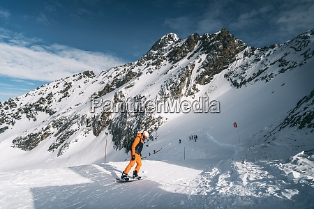 snowboarder going down the slope at