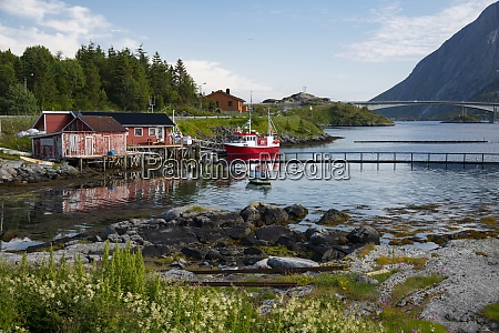 a fishing boat and dock houses