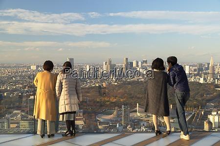 people on rooftop of shibuya scramble