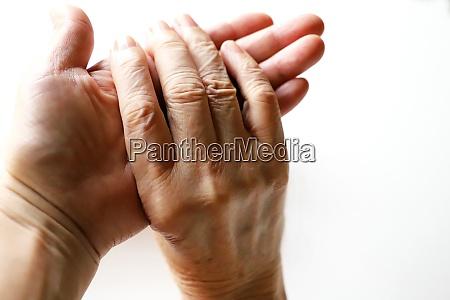 senior woman grandma and daughters hands