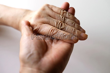 senior women grandma and daughter hands