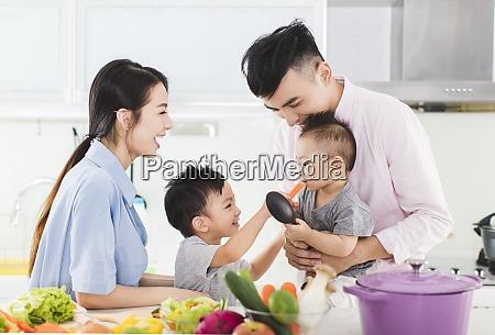 parent and boy feeding son a