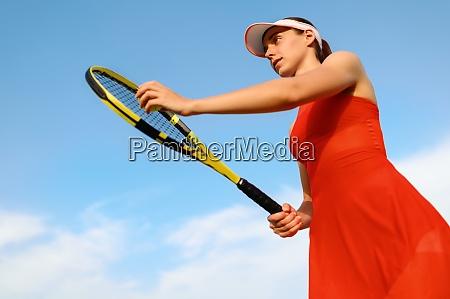 female tennis player prepares to hit