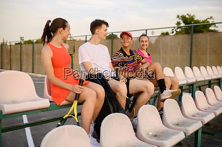 mixed doubles tennis players are resting