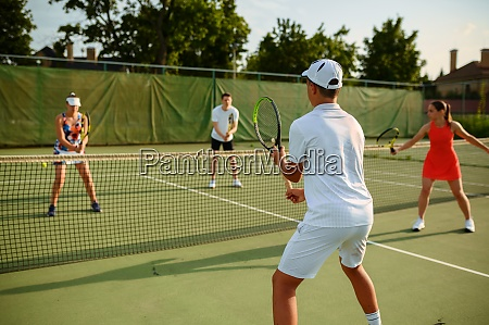mixed doubles tennis training outdoor court