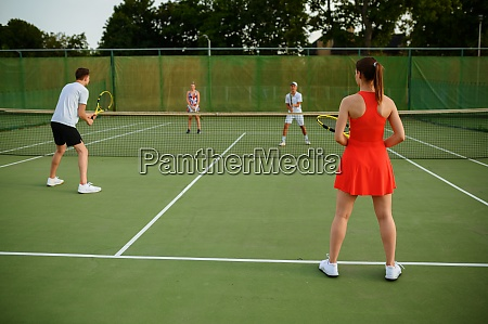 mixed doubles tennis players outdoor court