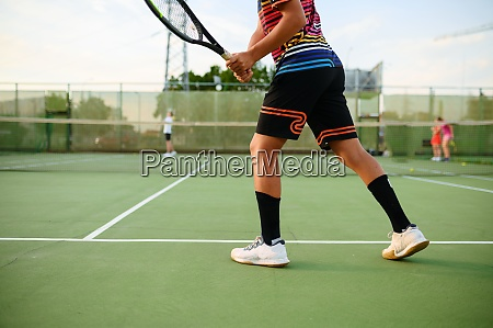 athletic tennis players training on outdoor