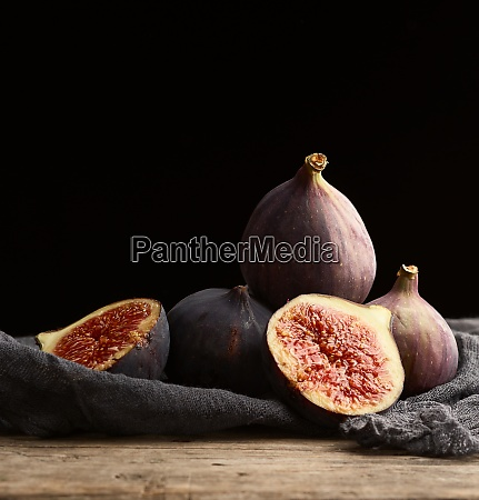 ripe whole and halved purple figs